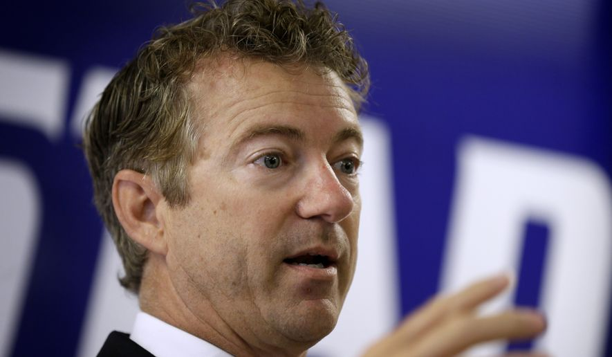 Sen. Rand Paul, R-Ky. speaks during a stop with local Republicans, Tuesday, Aug. 5, 2014, in Hiawatha, Iowa. (AP Photo/Charlie Neibergall)