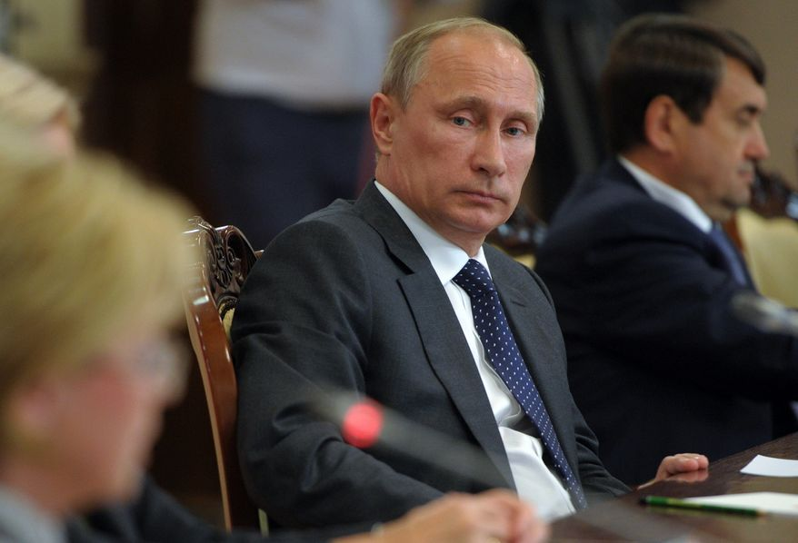 """Russian President Vladimir Putin attends a meeting with local officials in Voronezh, Russia, Tuesday, Aug. 5, 2014. Putin says he has ordered the government to develop measures in response to Western sanctions. In a meeting with state officials in the city of Voronezh on Tuesday, did not specify what the measures might be but said: """"I have given the order today to formulate them,"""" Russian news agencies reported. (AP Photo/RIA-Novosti,  Alexei Druzhinin, Presidential Press Service)"""