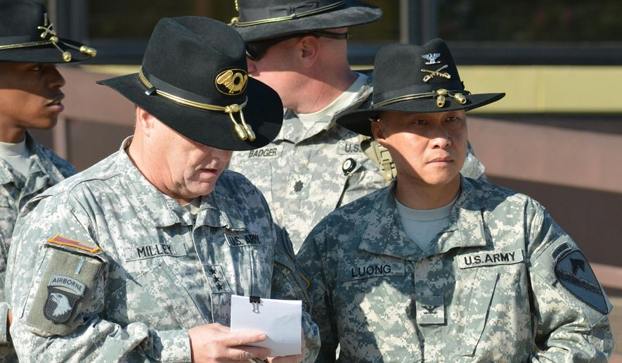 Fort Hood commander, Lt. Gen. Mark Milley, left, and Col. Viet Luong attend Luong's promotion ceremony, Wednesday, Aug. 6, 2014. Luong has become the first Vietnamese-American to reach the rank of general in the U.S. Army. (AP Photo/Killeen Daily Herald, Bryan Correira)