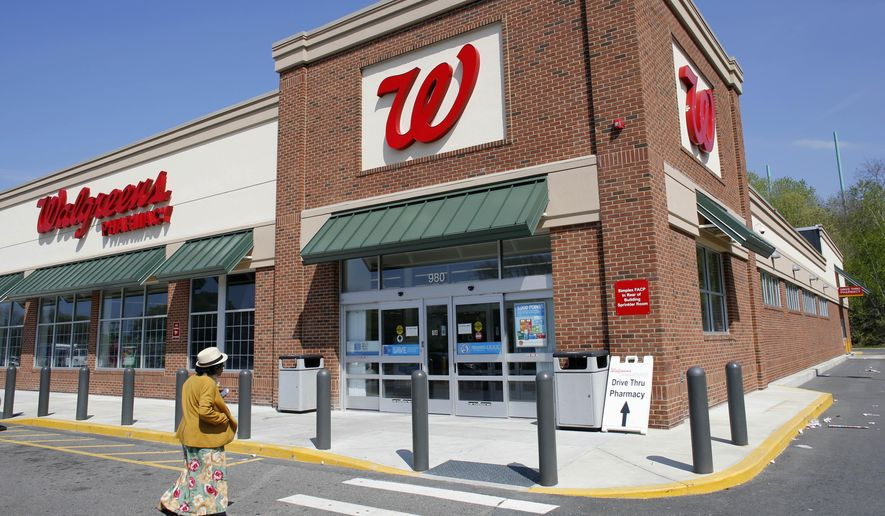 in this wednesday may 14 2014 photo a customer walks toward an entrance - Walgreens Christmas Commercial