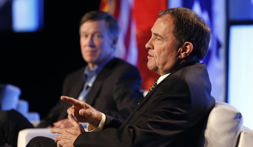 Utah Gov. Gary Herbert gestures, as Colo. Governor John Hickenlooper sits at left, during a forum session at the Rocky Mountain Energy Summit, in Denver, Wednesday Aug. 6, 2014. (AP Photo/Brennan Linsley)