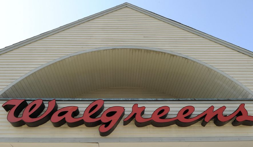 FILE - Sign above a Walgreens entrance, is seen in this, Sept. 28, 2009 file photo taken in Gloucester, Mass. The nation's largest drugstore chain says it will buy the remaining stake in Alliance Boots that it does not already own, but it will not pull off an inversion with the Swiss health and beauty retailer. (AP Photo/Lisa Poole, File)