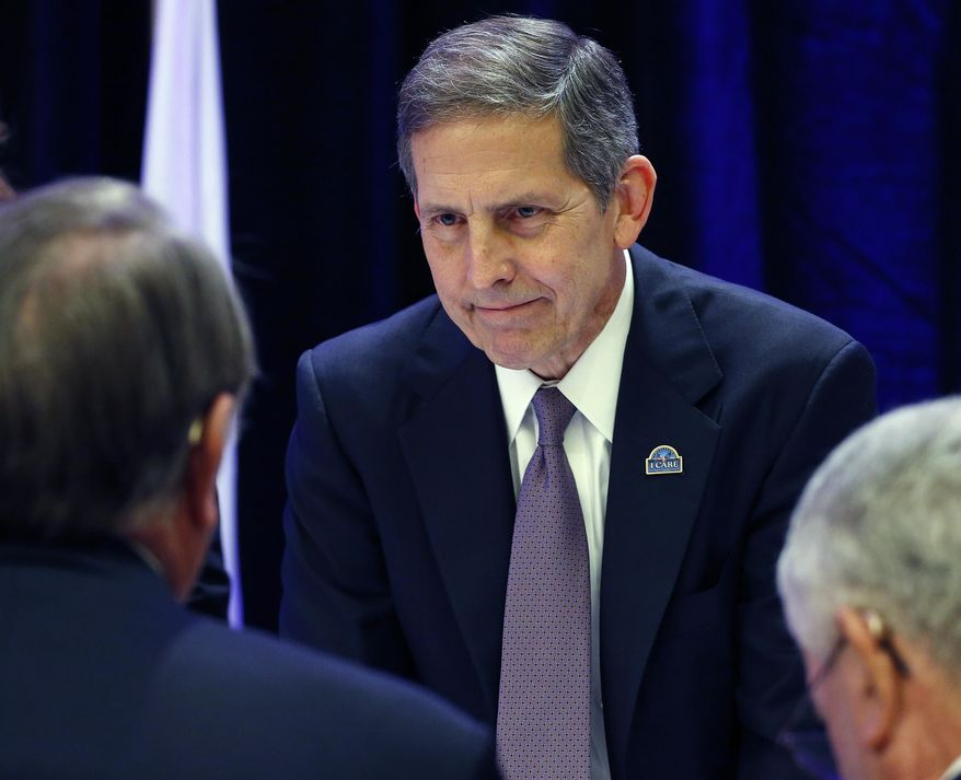U.S. Veterans Administration Deputy Secretary Sloan Gibson speaks with attendees during the opening session of the National Order of the Purple Heart National Convention in Denver, Tuesday, Aug. 5, 2014. Gibson says more employees will be disciplined as the department sorts out a scandal over long waits for health care and falsified data. (AP Photo/Brennan Linsley)
