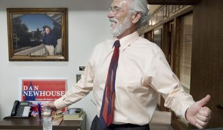 Fourth Congressional District candidate Dan Newhouse smiles after learning Aug. 5, 2014 in Yakima, Wash. that he was one of the top two finishers in the congressional primary. Newhouse will face fellow Republican Clint Didier in the general election. (AP Photo/Yakima Herald-Republic, Gordon King)
