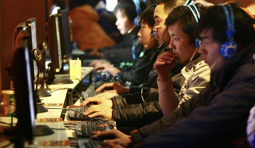 In this file photo taken Friday, Jan. 15, 2010, people use computers at an Internet cafe in Fuyang in central China's Anhui province. (AP Photo/File)