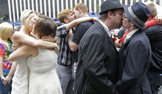 Several gay couples kiss after they were united in a commitment ceremony, Wednesday, Aug. 6, 2014, on Fountain Square in Cincinnati. Three judges of the 6th U.S. Circuit Court of Appeals in Cincinnati are set to hear arguments Wednesday in six gay marriage fights from four states, Kentucky, Michigan, Ohio and Tennessee. (AP Photo/Al Behrman)
