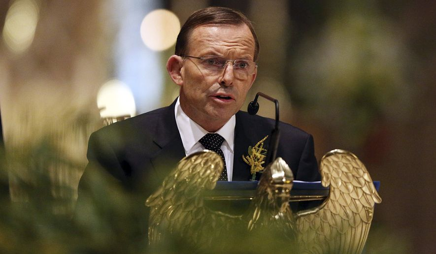 Australian Prime Minister Tony Abbott speaks during a national memorial service for the victims of Malaysia Airlines Flight 17 at St Patrick's Cathedral in Melbourne, Australia Thursday, Aug. 7, 2014. Abbott said on Thursday those responsible for shooting down the Malaysian airliner over Ukraine will face judgment, as his nation marked a day of mourning for the 38 Australian citizens and residents who died in the crash. (AP Photo/Graham Denholm, Pool)