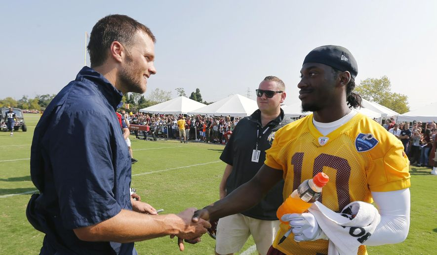New England Patriots quarterback Tom Brady, left, greets Washington Redskins quarterback Robert Griffin III after a joint team practice in Richmond, Va., Wednesday, Aug. 6, 2014. (AP Photo/The Richmond Times-Dispatch/ Joe Mahoney)