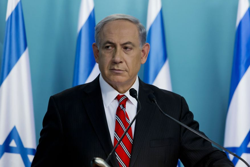 "Israeli Prime Minister Benjamin Netanyahu listens during a press conference in Jerusalem on Wednesday, Aug. 6, 2014. Netanyahu defended Israel's intense bombardment of Gaza, saying that despite the high civilian death toll it was a ""justified"" and ""proportionate"" response to Hamas attacks. (AP Photo/Jim Hollander, Pool)"
