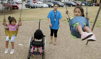 """Building a local playground or library isn't the federal government's job,"" writes Christine O'Donnell. ""If these things will enrich a community, then it's up to the local government to pay for it, or, better yet, to find a private charity to build them."" (AP Photo/The Fort Worth Star-Telegram, Khampha Bouaphanh)"
