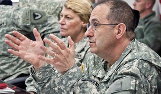 In this March 3, 2011 photo provided by the U.S. Army, Brig. Gen. Harold Greene, right, speaks beside Gen. Ann Dunwoody at the Natick Soldier Systems Center in Natick, Mass. Maj. Gen. Greene, the two-star Army general who on Tuesday, Aug. 5, 2014, became the highest-ranking U.S. military officer to be killed in either of America's post-9/11 wars, was an engineer who rose through the ranks as an expert in developing and fielding the Army's war materiel. He was on his first deployment to a war zone.(AP Photo/U.S. Army, David Kamm)