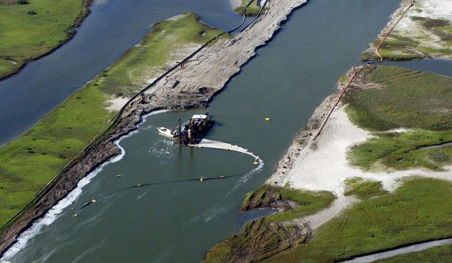 The contractor in charge of the nearly $10 million dredging of Cedar Bayou north of Rockport, Texas announced last week July 28, 2014 the job is about 75 percent complete on the 1.6 mile project. The channel could be flowing by September, which is about a month earlier than the project's Oct. 15 deadline set by the U.S. Army Corps of Engineers. (AP Photo/Corpus Christi Caller-Times, David Sikes)