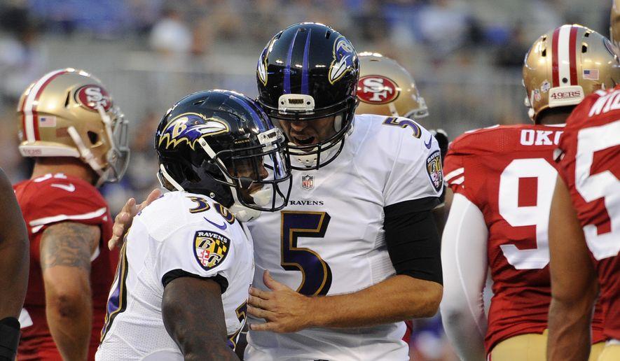 Baltimore Ravens running back Bernard Pierce, left, and quarterback Joe Flacco celebrate Pierce's touchdown in the first half of an NFL preseason football game against the San Francisco 49ers, Thursday, Aug. 7, 2014, in Baltimore. (AP Photo/Nick Wass)