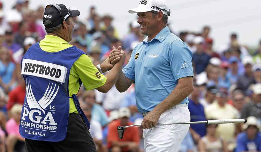 Lee Westwood, of England, right, shakes hand with his caddie after firing a 6-under par first round of the PGA Championship golf tournament at Valhalla Golf Club on Thursday, Aug. 7, 2014, in Louisville, Ky. (AP Photo/David J. Phillip)