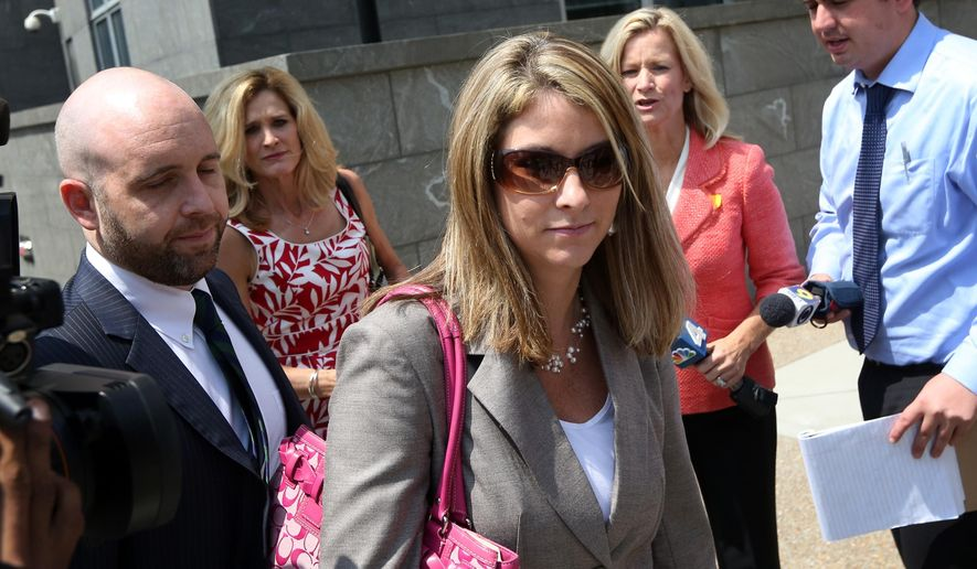 Former Mansion Director Sarah Scarbrough leaves the federal courthouse in Richmond, Va.,  on Thursday, Aug. 7, 2014, after testifying in the trial of former Gov. Bob McDonnell and his wife Maureen.  The McDonnells are charged with accepting more than $165,000 in gifts and secret loans from former Star Scientific Inc. CEO Jonnie Williams in exchange for promoting his dietary supplement products. (AP Photo/The Virginian-Pilot, Steve Earley)  MAGS OUT