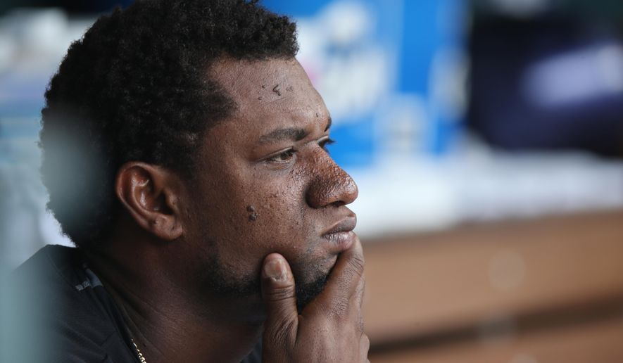 Colorado Rockies starting pitcher Yohan Flande sits in the dugout after being pulled against the Chicago Cubs after the sixth inning of the Cubs' 6-2 victory in a baseball game in Denver on Thursday, Aug. 7, 2014. (AP Photo/David Zalubowski)