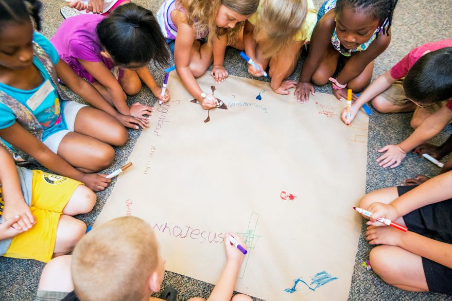 KEEPING THE FAITH: Students at the 6-year-old level use the last day of Bible school to illustrate what they've learned this summer at the Church at Severn Run. (Eva Russo/Special to The Washington Times)