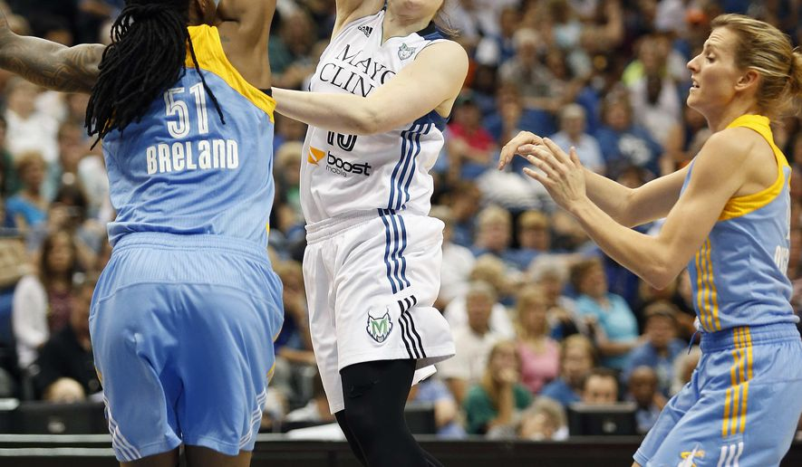 Minnesota Lynx guard Lindsay Whalen (13) passes the ball around Chicago Sky forward Jessica Breland (51) in the second half of a WNBA basketball game, Thursday, Aug. 7, 2014, in Minneapolis. The Lynx won 74-64. (AP Photo/Stacy Bengs)
