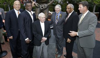 Former Baltimore Orioles Cal Ripken, Jr., from left, Eddie Murray, Earl Weaver, Brooks Robinson, Frank Robinson and Jim Palmer stand in front of a statue of Brooks Robinson after it was unveiled before a baseball game between the Orioles and the Boston Red Sox in Baltimore, Saturday, Sept. 29, 2012. (AP Photo/Patrick Semansky)