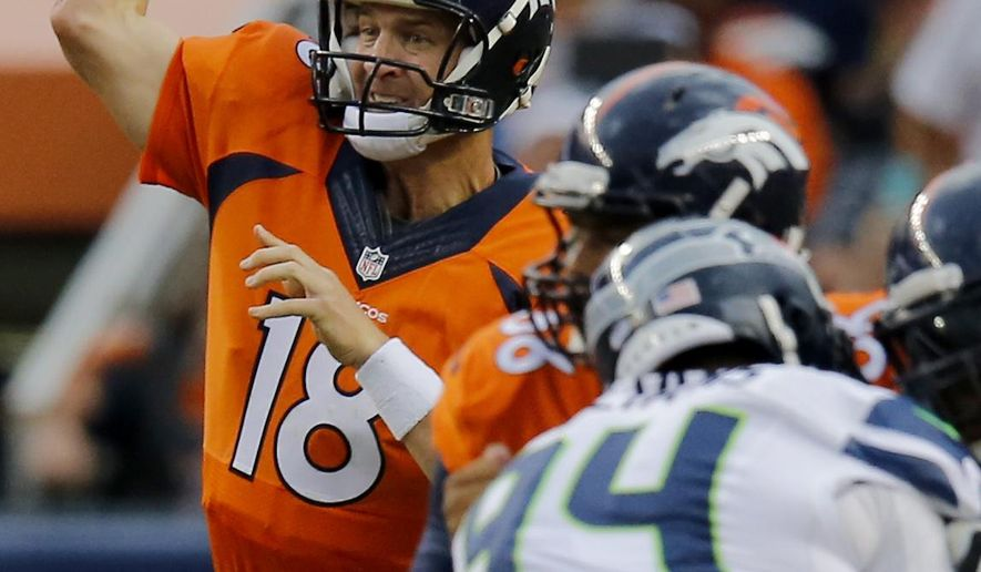 Denver Broncos quarterback Peyton Manning (18) throws against the Seattle Seahawks during the first half of an NFL preseason football game, Thursday, Aug. 7, 2014, in Denver. (AP Photo/Jack Dempsey)