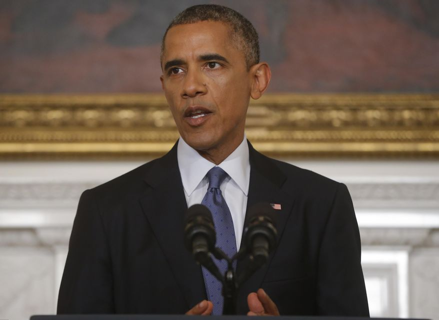 President Barack Obama speaks about the situation in Iraq in the State Dining Room at the White House in Washington, Thursday, Aug. 7, 2014. (AP Photo/Charles Dharapak)
