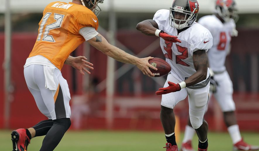 Tampa Bay Buccaneers quarterback Josh McCown (12) hands off to running back Jeff Demps during an NFL football training camp Monday, Aug. 4, 2014, in Tampa, Fla. (AP Photo/Chris O'Meara)