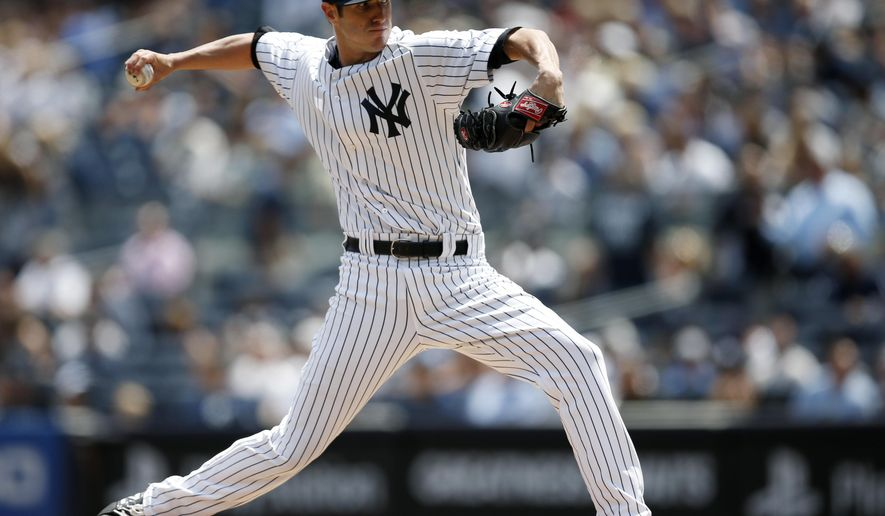 New York Yankees starting pitcher Shane Greene delivers in the first inning of a baseball game against the Detroit Tigers at Yankee Stadium in New York, Thursday, Aug. 7, 2014.  (AP Photo/Kathy Willens)