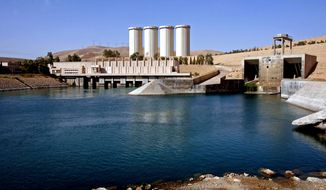 FILE - This Oct. 31, 2007 file photo, shows a general view of the dam in Mosul, 360 kilometers (225 miles) northwest of Baghdad, Iraq. Residents living near Iraq's largest dam say Sunni militants from the Islamic State group have overrun the complex. The residents say the militants stormed the Mosul Dam complex in one hour on Thursday, Aug. 7, 2014. (AP Photo/ Khalid Mohammed, File)