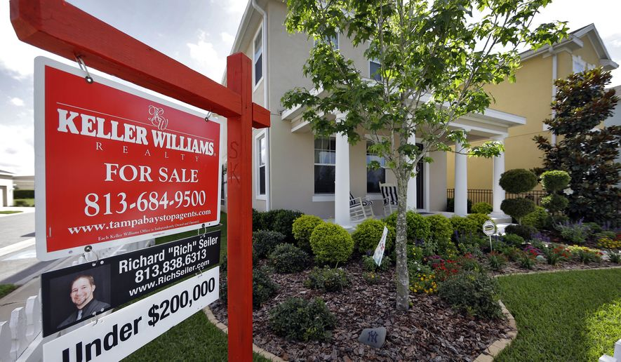 FILE - This May 14, 2014 file photo shows a new home for sale in the Winthrop subdivision in Riverview, Fla. Freddie Mac reports on average U.S. mortgage rates for this week on Thursday, Aug. 7, 2014. (AP Photo/Chris O'Meara, File)