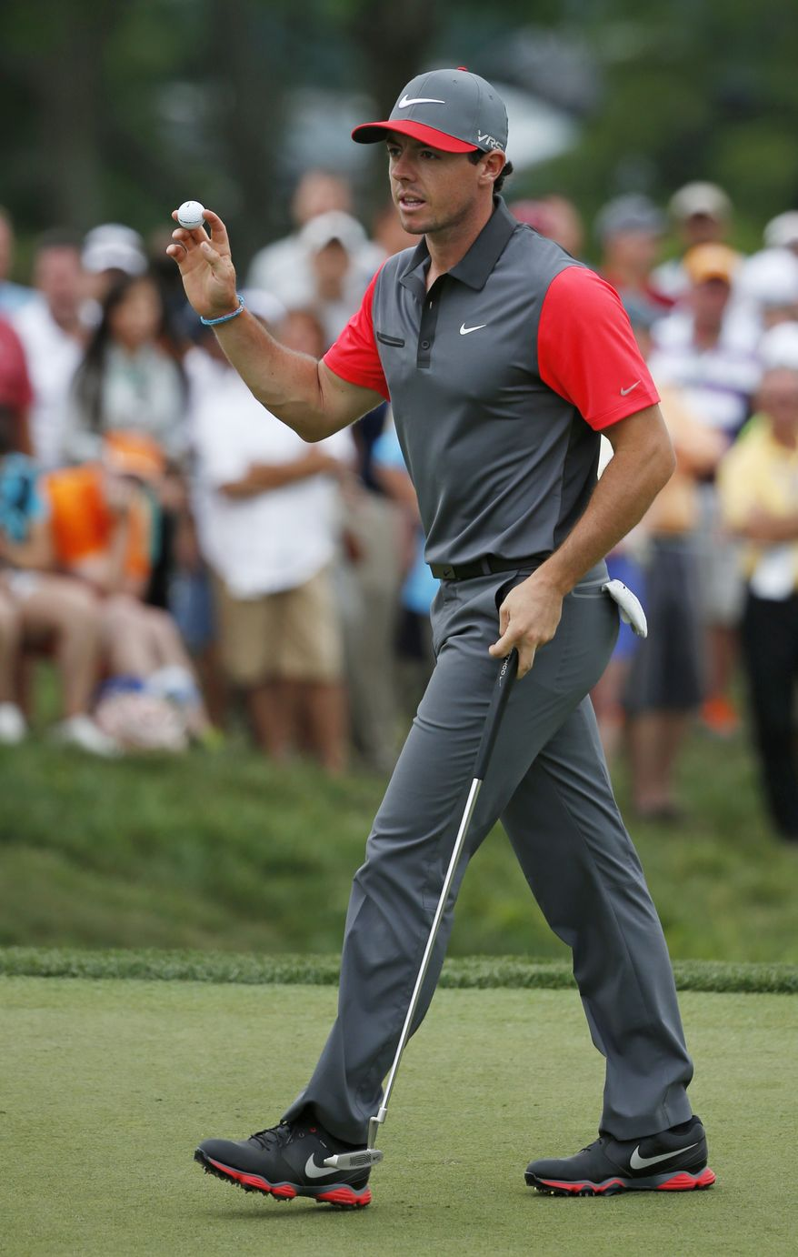 Rory McIlroy, of Northern Ireland, waves after making a birdie putt on the ninth hole during the first round of the PGA Championship golf tournament at Valhalla Golf Club on Thursday, Aug. 7, 2014, in Louisville, Ky. (AP Photo/Mike Groll)