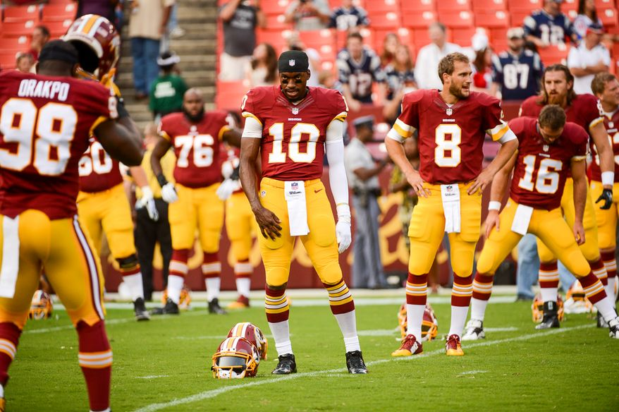 Washington Redskins quarterback Robert Griffin III (10) and his teammates stretch during warm ups before the Washington Redskins play the New England Patriots in NFL preseason football at FedExField, Landover, Md.,  Thursday, August 7, 2014. (Andrew Harnik/The Washington Times)Monday, September 9, 2013. (Andrew Harnik/The Washington Times)