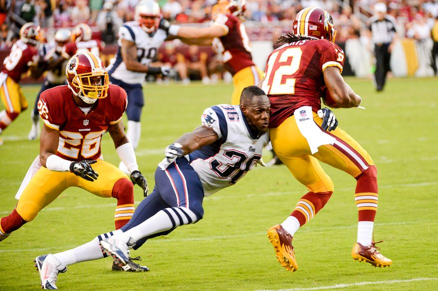 Washington Redskins wide receiver Andre Roberts (12) is tackled by New England Patriots defensive back Kanorris Davis (36) on a punt return as the Washington Redskins play the New England Patriots in NFL preseason football at FedExField, Landover, Md.,  Thursday, August 7, 2014. (Andrew Harnik/The Washington Times)Monday, September 9, 2013. (Andrew Harnik/The Washington Times)