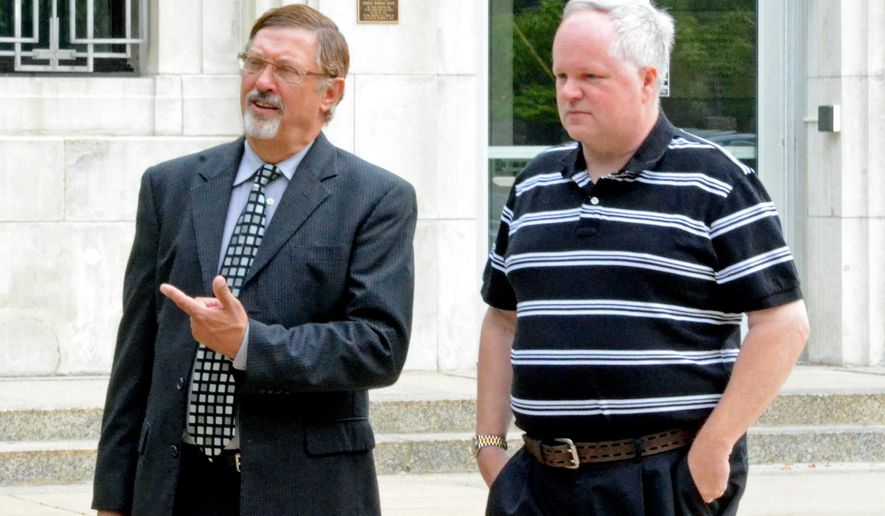 William Melchert-Dinkel, right, and his attorney Terry Watkins leave court Friday, Aug. 8, 2014, in Faribault, Minn. Minnesota prosecutors argued Friday that Melchert-Dinkel, a former nurse, should be convicted of assisting suicide for sending emails and other online communications in which he urged two people to kill themselves and gave them information on how to do it. The court earlier this year reversed Melchert-Dinkel's previous conviction of encouraging suicides saying the state's law against it was too broad. (AP Photo/Faribault Daily News, Chris Houck)