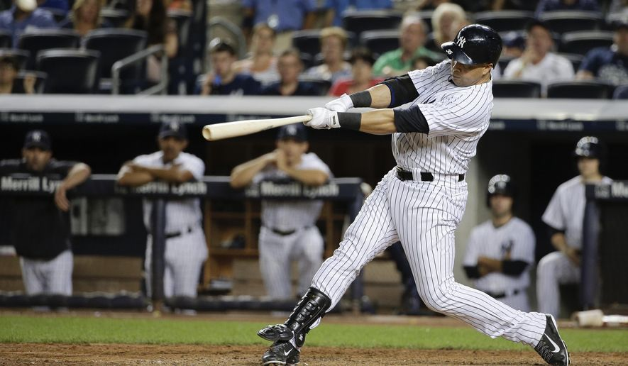 New York Yankees designated hitter Carlos Beltran (36) connects for a grand slam home run against the Cleveland Indians in the sixth inning of a baseball game, Friday, Aug. 8, 2014, in New York. (AP Photo/Julie Jacobson)