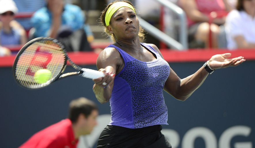 Serena Williams returns to Caroline Wozniacki, of Denmark, at the Rogers Cup tennis tournament Friday, Aug. 8, 2014,  in Montreal. (AP Photo/The Canadian Press, Paul Chiasson)