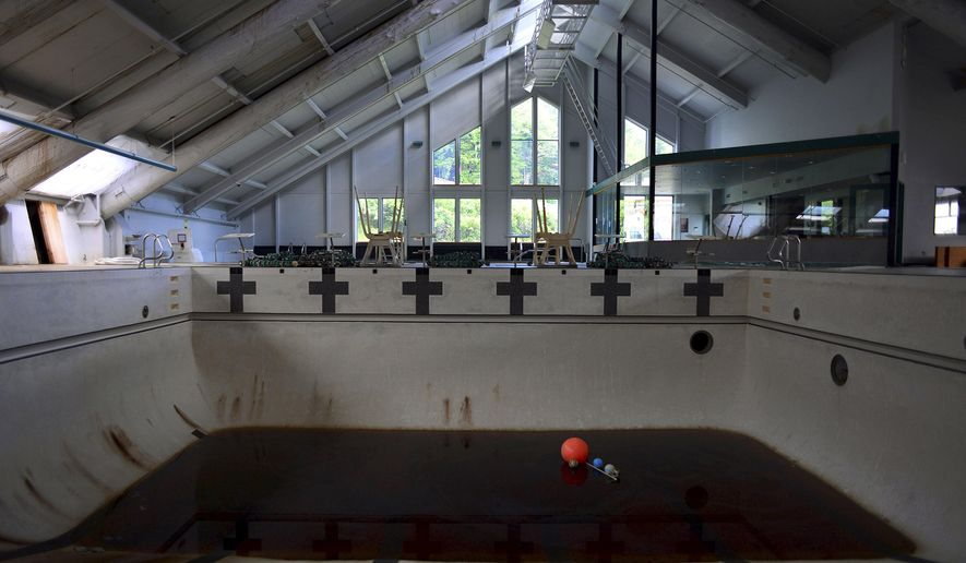 This Aug. 6, 2014 photo shows the inside of the Mike Smithers pool in Ketchikan, Alaska. The Ketchikan Gateway Borough Assembly has approved a contract to demolish the building within six months. (AP Photo/Ketchikan Daily News, by Nick Bowman)