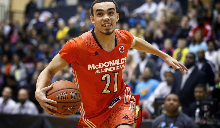 FILE - In this March 31, 2014, file photo, McDonald's East All-American Tyus Jones, of Apple Valley, Minn., competes in the skills contest during the McDonald's All-American Jam Fest at the University of Chicago in Chicago. Jones doesn't view the point guard position at Duke as a competition. More like a collaboration. The Duke freshman says he's not working against incumbent starter Quinn Cook. Instead, they're working together. (AP Photo/Andrew A. Nelles, File)