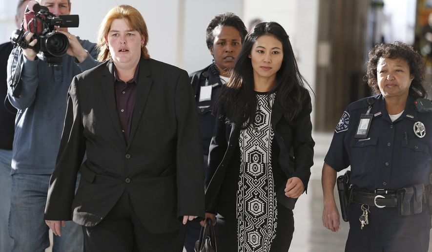 FILE - In this Nov. 15, 2013 file photo, Lorinda Bailey, left, arrives at court with her attorney Chelsea Reiss and a police escort at the Denver Justice Center, in Denver. Bailey pleaded guilty to a second offense of child abuse on Friday, Aug. 8, 2014, in exchange, six other counts are being dropped. Bailey and Wayne Sperling were accused of keeping their four boys, ages 2 to 6, in an apartment filled with cat feces and flies. When police found the children in October, they could communicate only in grunts, were malnourished and weren't toilet trained. (AP Photo/Brennan Linsley, File)