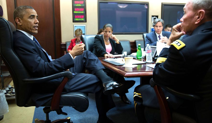 In this image released by The White House, President Barack Obama meets with the National Security Council  in the Situation Room of the White House, Thursday morning, Aug. 7, 2014, in Washington. (AP Photo/The White House, Pete Souza)