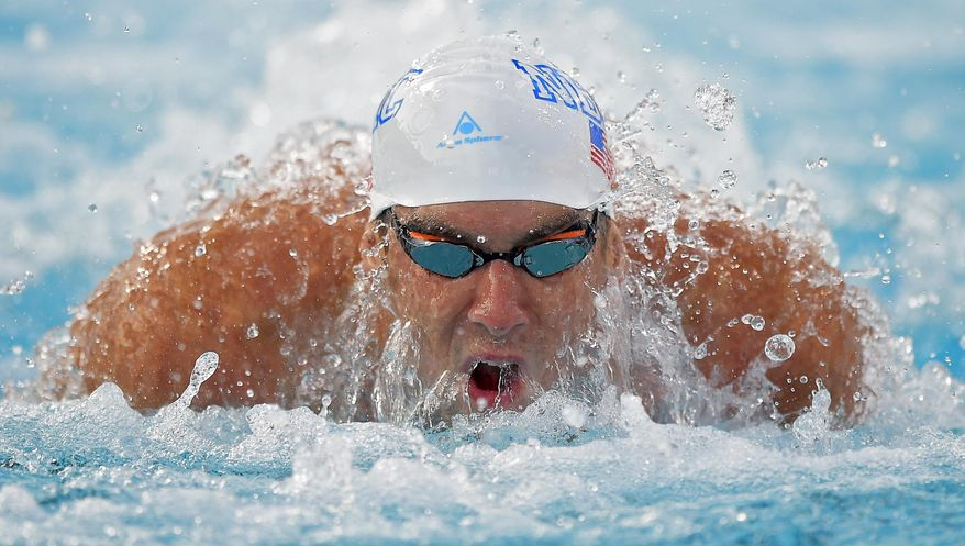 Michael Phelps swims in the men's 100 meter butterfly final at the U.S. nationals of swimming, Friday, Aug. 8, 2014, in Irvine, Calif. Phelps took second in the event. (AP Photo/Mark J. Terrill)