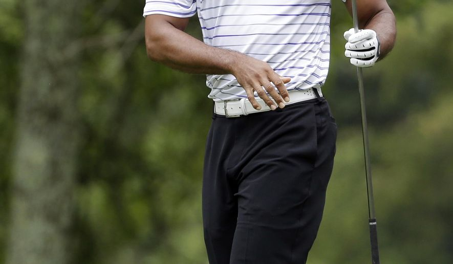 Tiger Woods watches his tee shot on the second hole during the second round of the PGA Championship golf tournament at Valhalla Golf Club on Friday, Aug. 8, 2014, in Louisville, Ky. (AP Photo/Jeff Roberson)