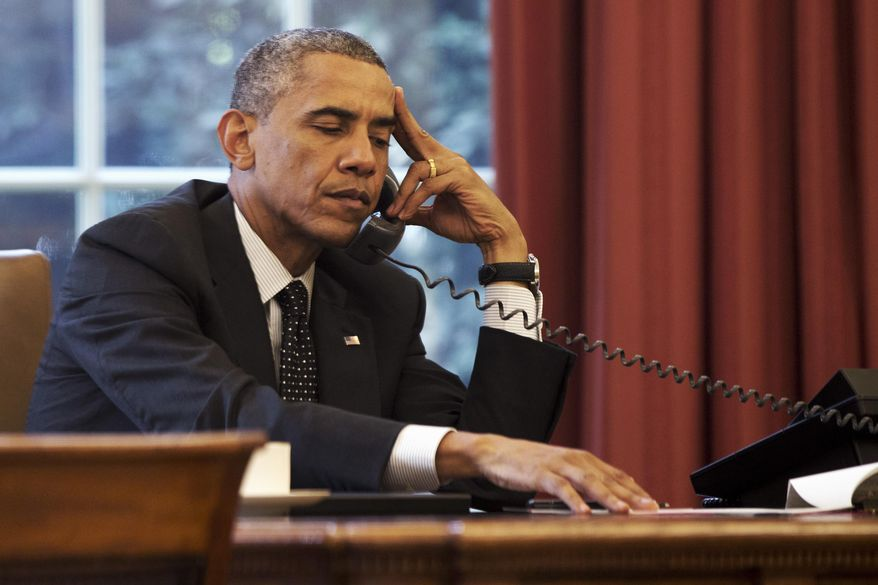 President Barack Obama listens during a phone call with Jordan's King Abdullah II Jordan, according to the White House, Friday, Aug. 8, 2014, in the Oval Office of the White House in Washington. (AP Photo/Jacquelyn Martin) **FILE**
