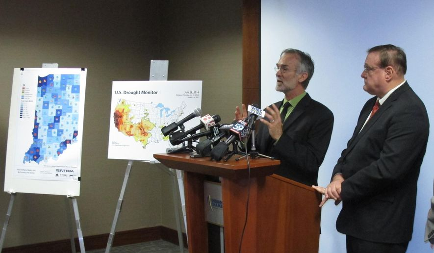 Geoscientist Jack Wittman, left, describes the findings of his report commissioned by the Indiana Chamber of Chamber on the state's water supplies and future water needs during a news conference on Friday, Aug. 8, 2014, in Indianapolis. Wittman's report concludes that Indiana needs more money and a single, state-level planning entity to ensure that the state's businesses and communities have ample water in the decades ahead. To Wittman's left is Kevin Brinegar, the chamber's president and CEO. (AP Photo/Rick Callahan)