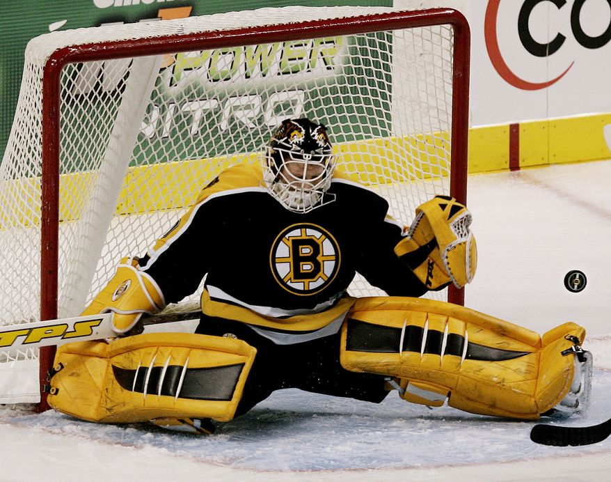 TIM THOMAS-The NHL goalie declined to attend a ceremony staged by the Obama White House after the Boston Bruins won the Stanley Cup. Boston Bruins goaltender Tim Thomas makes a split save, one of 38 saves he made, during the Bruins 2-1 overtime shootout loss to the Dallas Stars in NHL hockey in Boston Saturday, Jan. 14, 2006. (AP Photo/Winslow Townson)