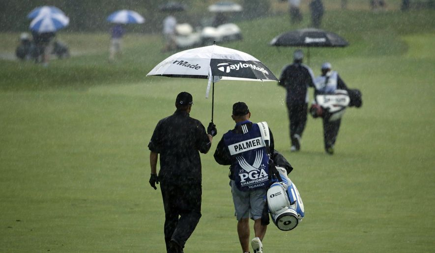 Ryan Palmer walks down the fairway on the first hole during the second round of the PGA Championship golf tournament at Valhalla Golf Club on Friday, Aug. 8, 2014, in Louisville, Ky. (AP Photo/Jeff Roberson)