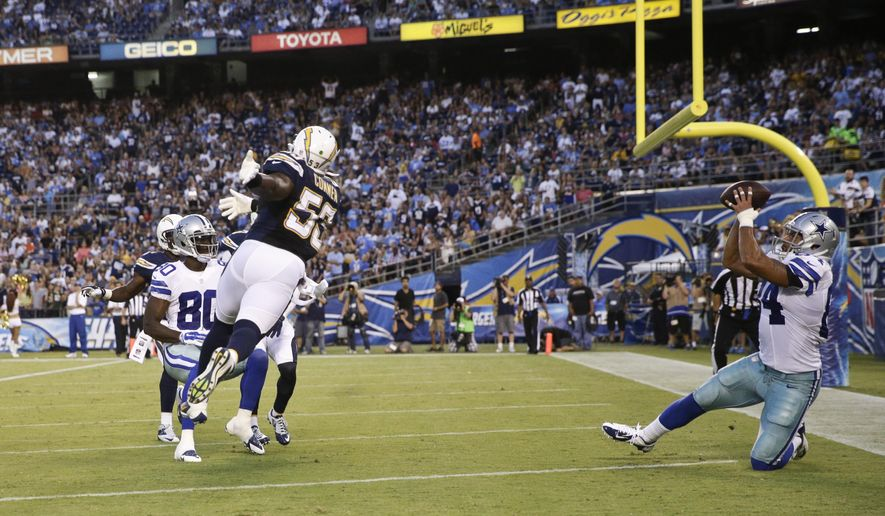 Dallas Cowboys tight end James Hanna catches a 4-yard touchdown pass against the San Diego Chargers during the first half of a preseason NFL football game Thursday, Aug. 7, 2014, in San Diego. (AP Photo/Jae C. Hong)