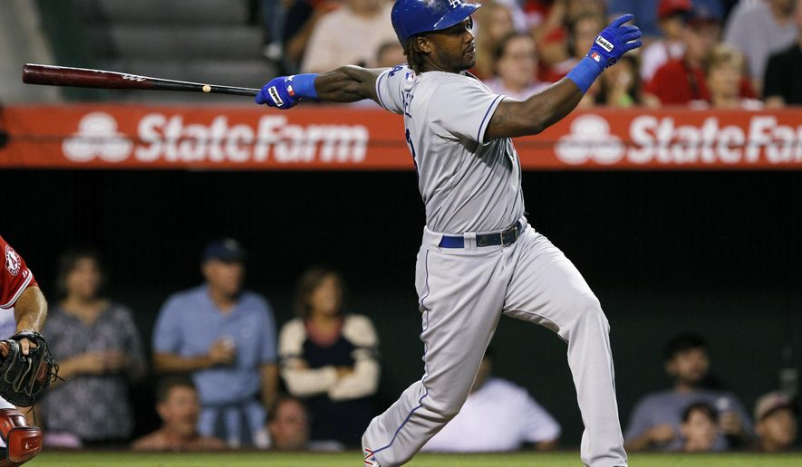 Los Angeles Dodgers designated hitter Hanley Ramirez follows through on a two-run single against the Los Angeles Angels in the third inning of a baseball game Thursday, Aug. 7, 2014, in Anaheim, Calif. (AP Photo/Alex Gallardo)