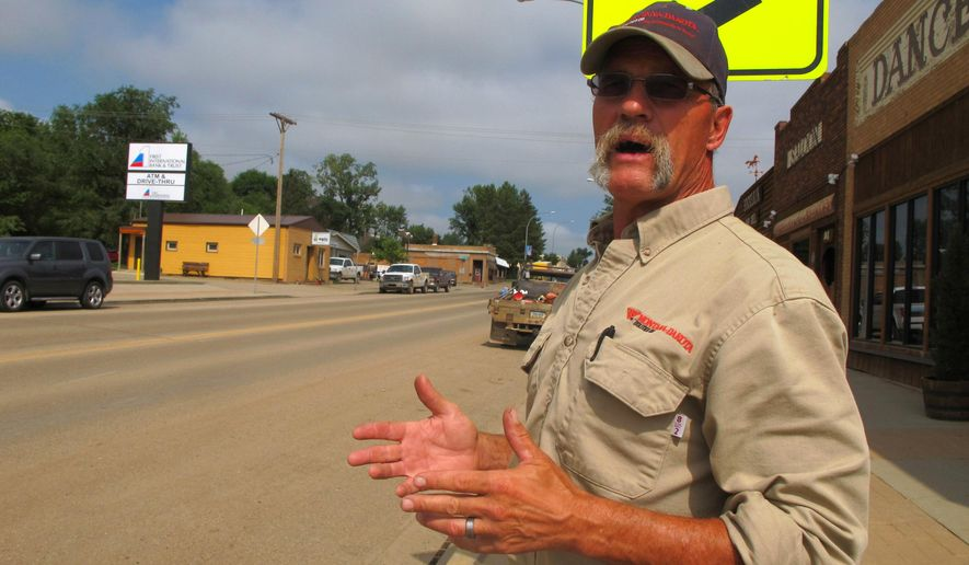 In this Aug. 6, 2014 photo, Killdeer, N.D. mayor Chuck Muscha talks about the heavy traffic on Highway 22, which also serves as the town's main thoroughfare. Residents of the western oil patch town say a planned highway bypass around the community is welcome. (AP Photo/The Bismarck Tribune, Lauren Donovan)