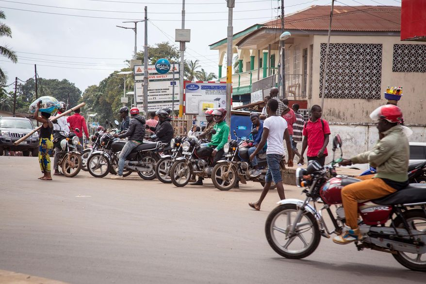Motorcycle taxis called Okadas, used by the Sierra Leone people as affordable transport have been ordered of the roads from 7am to 7pm, local time to reduce the movement of the local population, by the Government in the city of Freetown, Sierra Leone, Thursday, Aug. 7, 2014.  While the Ebola virus outbreak has now reached four countries, Liberia and Sierra Leone account for more than 60 percent of the deaths, according to the World Health Organization, and the outbreak that emerged in March has claimed at least 932 lives.  (AP Photo/ Michael Duff)