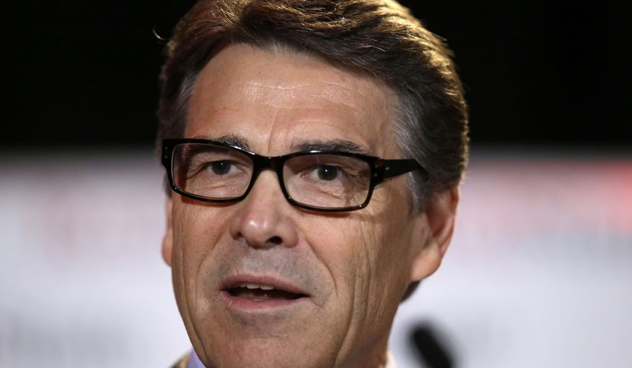 ** FILE ** Texas Gov. Rick Perry delivers a speech to nearly 300 in attendance at the 2014 RedState Gathering, Friday, Aug. 8, 2014, in Fort Worth, Texas. (Associated Press)